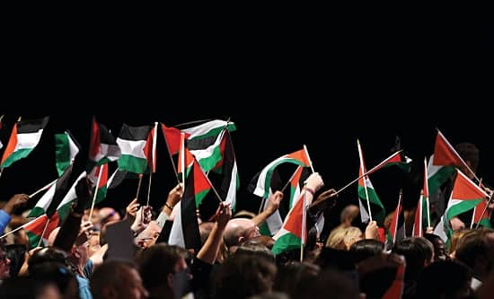 Attendees at Labour Conference 2018 wave Palestine flags