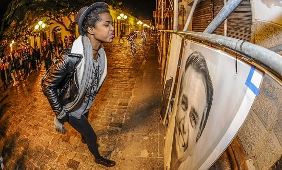 A woman spits on a picture of Jair Messias Bolsonaro
