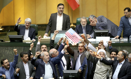Iranian MPs burn US flag
