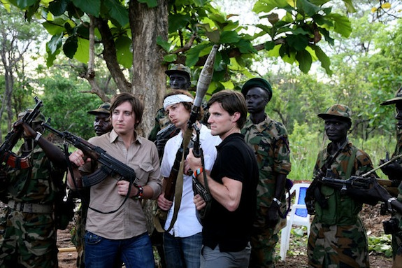 The makers of the Kony 2012 film pose with Ugandan troops, who have been accused of the same crimes that Kony is charged with