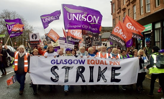 Thousands of low-paid women council workers and their supporters brought Glasgow to a halt in a historic walk-out over unequal pay