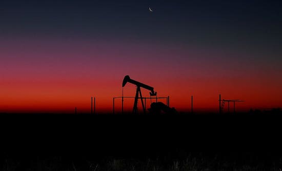 An oil pump in front of a sunset
